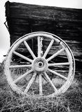 Antique wagon wheel. An up close black and white photo of an antique wagon wheel stock photos