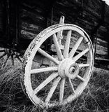 Antique wagon wheel. An up close black and white photo of an antique wagon wheel royalty free stock images