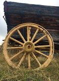 Antique wagon wheel. An up close photo of an antique wagon wheel stock photo