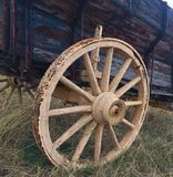 Antique wagon wheel. An up close photo of an antique wagon wheel royalty free stock photography