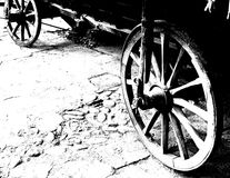 Antique Wagon Wheels. Close-Up of antique wagon wheels located in a fortress. Black and white Stock Images