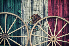 Antique Wagon Wheels with Mexico flag Royalty Free Stock Image