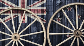 Antique Wagon Wheels with New Zealand flag Royalty Free Stock Images