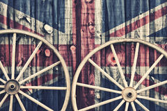 Antique Wagon Wheels with UK flag Stock Photo
