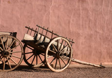 Antique Wagons and Adobe Wall. Antique wagons in front of an adobe wall in Tombstone Arizona Stock Image