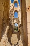Antique wall with arches of El Djem Amphitheatre in Tunisia royalty free stock photography