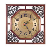 Antique wall clock with carved wooden frame Royalty Free Stock Image