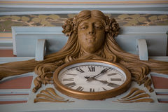 Antique wall clock moldings gilt low angle Royalty Free Stock Photography