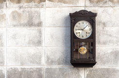 Antique wall clock with a pendulum Royalty Free Stock Image