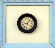 Antique wall clock in a picture frame Royalty Free Stock Photography