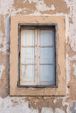 Antique wall element. Old window of abandoned house Royalty Free Stock Images