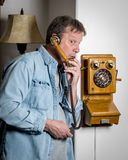 Antique wall phone and surprised expression Royalty Free Stock Photography