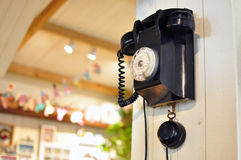 Antique wall telephone. Old retro wall telephone and cottage style background Royalty Free Stock Photo