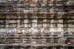 An antique wall of temple ruin Stock Photos