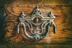 Antique wardrobe handle. Part of an antique woody cabinet Royalty Free Stock Photo