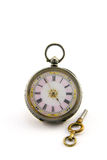 Antique Watch with Key. Ornate silver antique watch with key on a white background Royalty Free Stock Photos