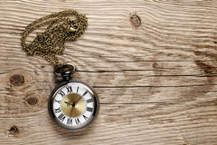 Antique watch on wood Stock Photo