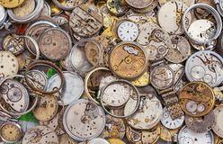 Antique watches of different shapes and sizes. Background with vintage clock royalty free stock image