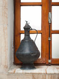 Antique water jug on a bathroom windowsill Royalty Free Stock Image