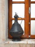 Antique water jug on a bathroom windowsill Royalty Free Stock Image