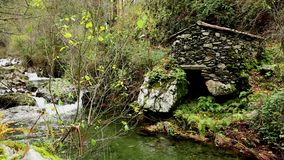 Antique water mill at Ribeira da Pena river next to Pena Village. Antique water mill at Ribeira da Pena river, Pena Schist Village - municipality of Gois stock footage