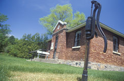 Antique water pump and jailhouse, MI Stock Photo