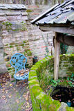 Antique Water Well With a Rope and a Bucket in a idyllic scene Stock Photography
