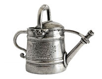 Antique watering can Stock Photo