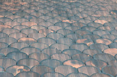 Antique weathered roof tiles Stock Images