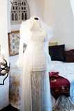 Antique wedding dress. An antique white wedding dress or bridal gown in an old bedroom Stock Image