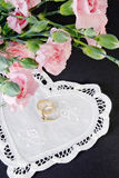 Antique wedding rings with carnations Royalty Free Stock Photo