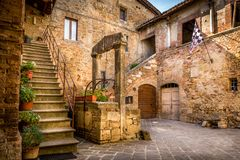 Antique well in Tuscany Stock Image