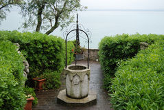 Antique well. Antique water well in italian old town Sirmione, Garda Lake, Italy royalty free stock photo
