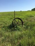 Antique Wheel. Antique tractor wheel laid to rest in the beautiful Flinthills Royalty Free Stock Image