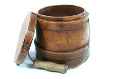 Antique on a White Background. An old wooden cream pot Stock Images
