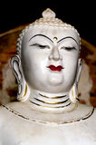 Antique white Buddha Portrait with prominent golden third eye Royalty Free Stock Images