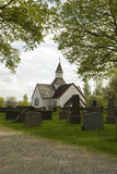 Antique white Church on Old cemetery. Royalty Free Stock Images