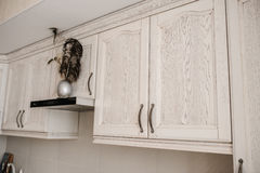 Antique white closet. Antique white painted cupboard closet, old hand made furniture in wood with drawers and doors stock images