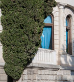 Antique white marble building and cypress. In high quality Stock Photography