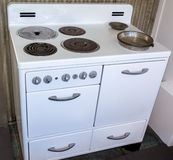 Antique white oven from the past with burners Royalty Free Stock Image