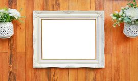 Antique white photo frame with empty space for your picture or text placed on wood plank wall background stock image