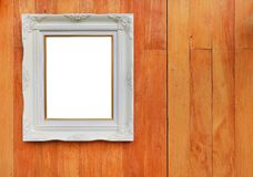 Antique white photo frame with empty space for your picture or text placed on wood plank wall background.  stock image