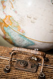 Antique Wicker Suitcase and Globe. Concept travel Royalty Free Stock Photos