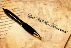 Antique Will with Pen. Pen laying on top of an antique Will for estate planning Royalty Free Stock Photography