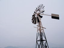 Antique wind mill by the sea Stock Photo