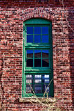 Antique Window on Abandoned Industrial Building stock photos