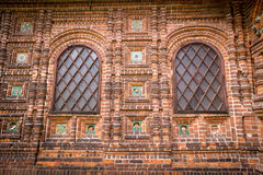 Antique windows in a red brick wall Stock Photo