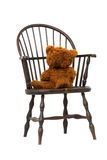 Antique Windsor chair with teddy bear isolated Royalty Free Stock Photo