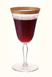 Antique Wine Glass. An antique gold-rimmed wine glass with red wine Royalty Free Stock Images