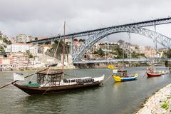 Antique winery boats moored at Douro river in Porto, Portugal Royalty Free Stock Photo